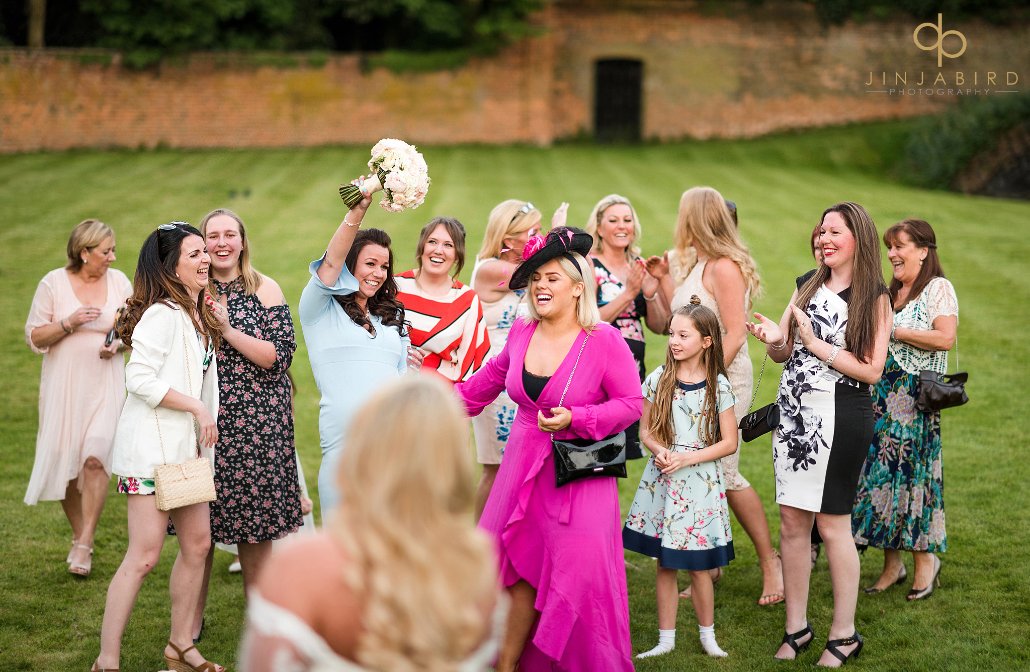 women catching bouquet