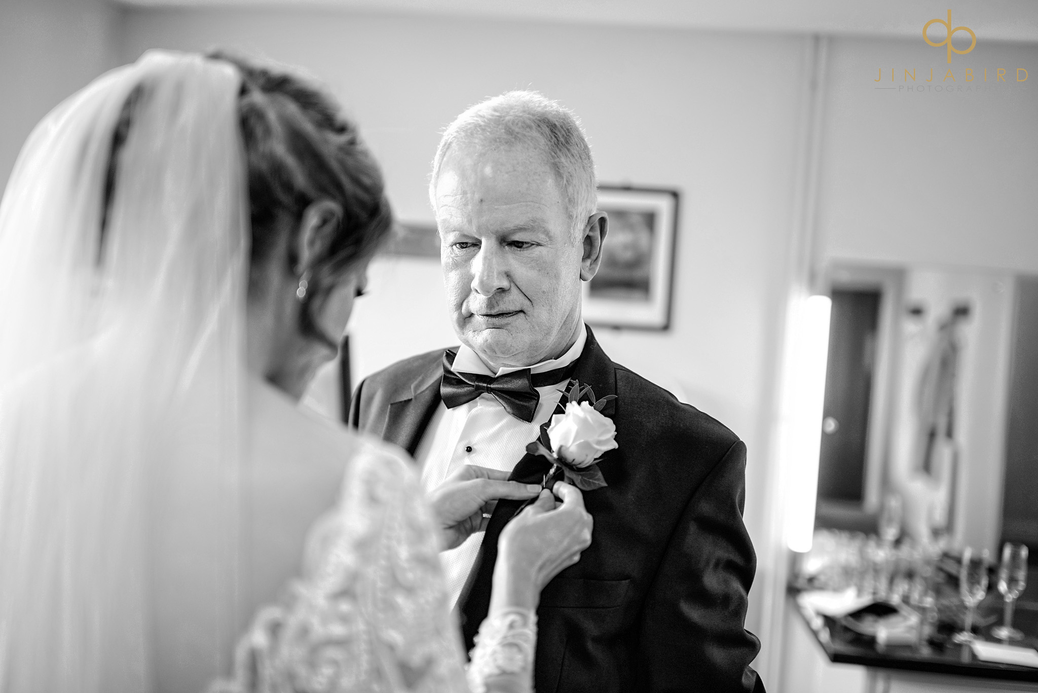 bride putting on fathers button hole