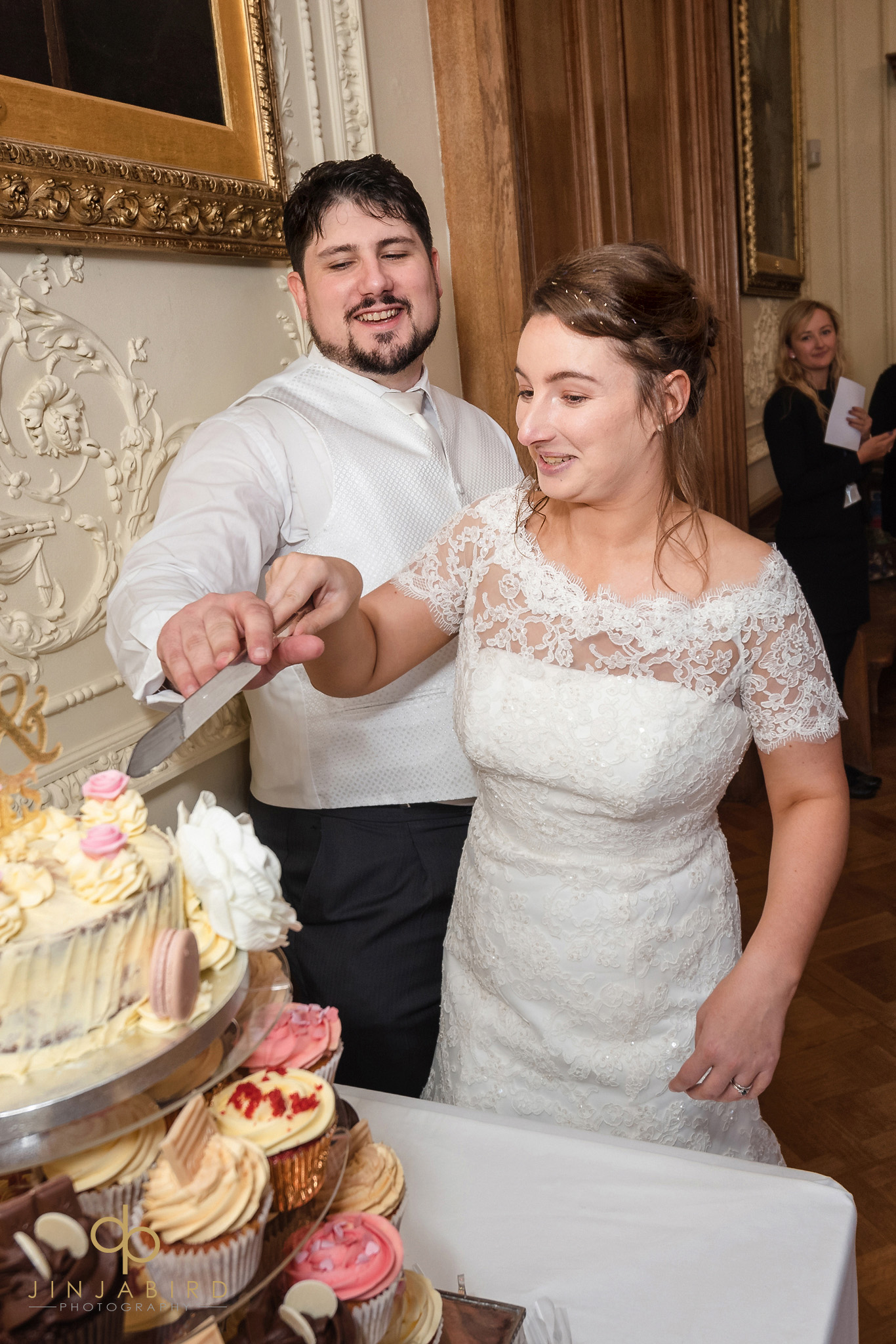 cutting wedding cake shuttleworth house