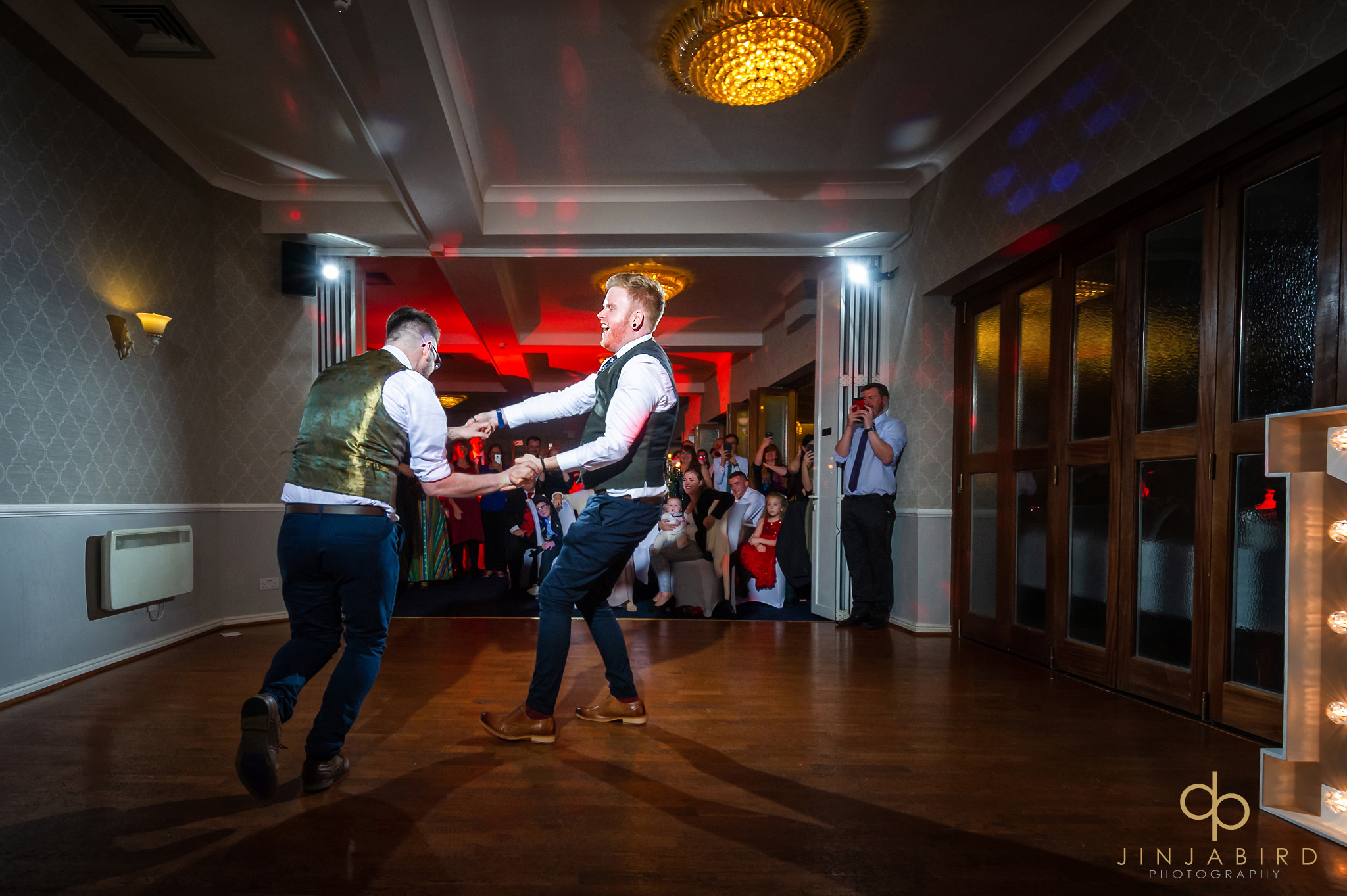 groom dancing with groom normanton park hotel