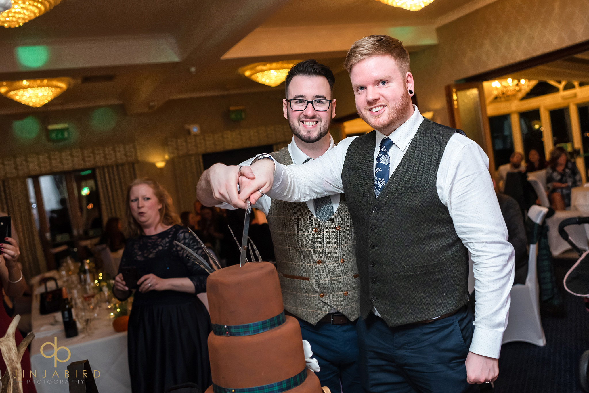 grooms cut wedding cake normanton park hotel