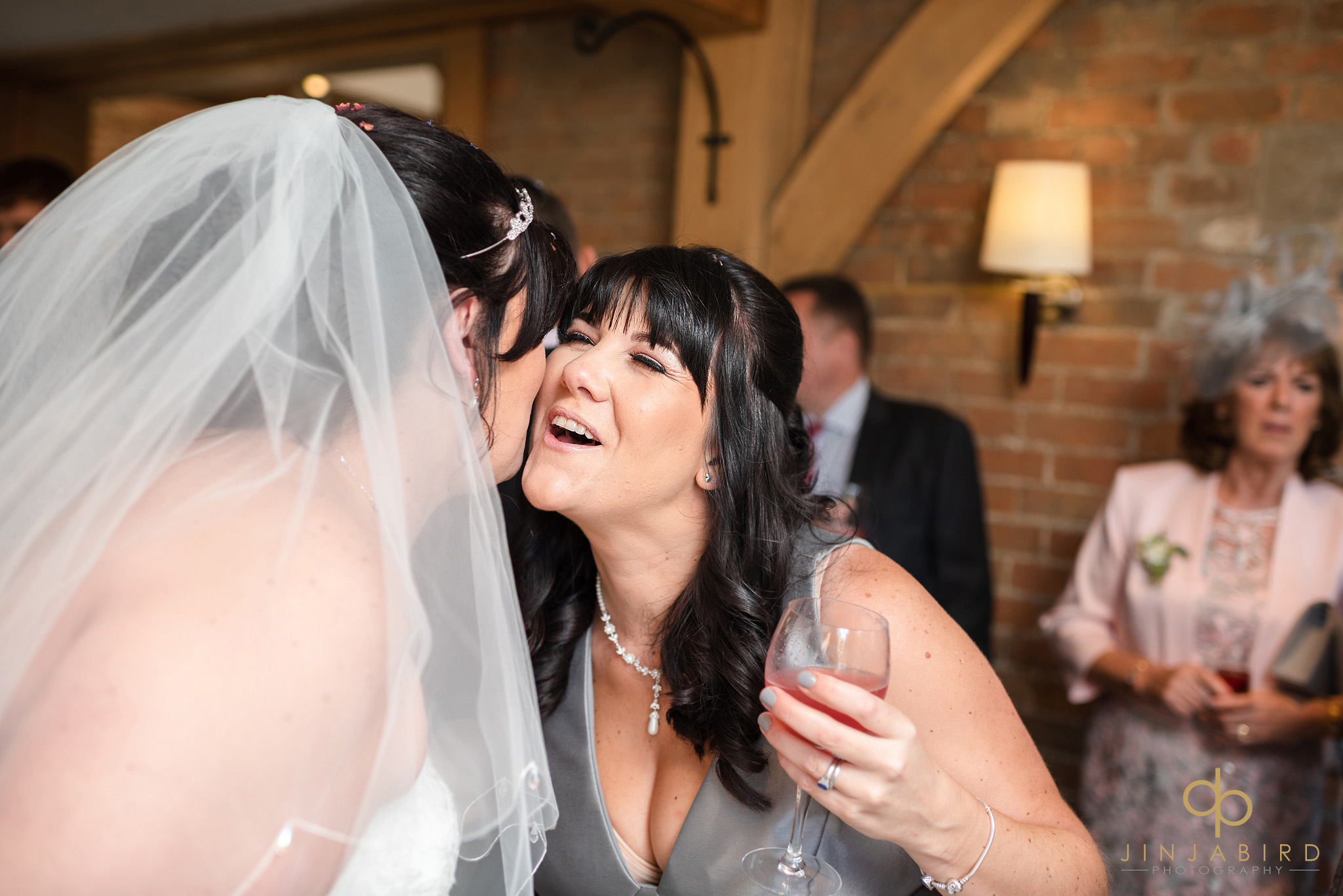 sister kissing bride