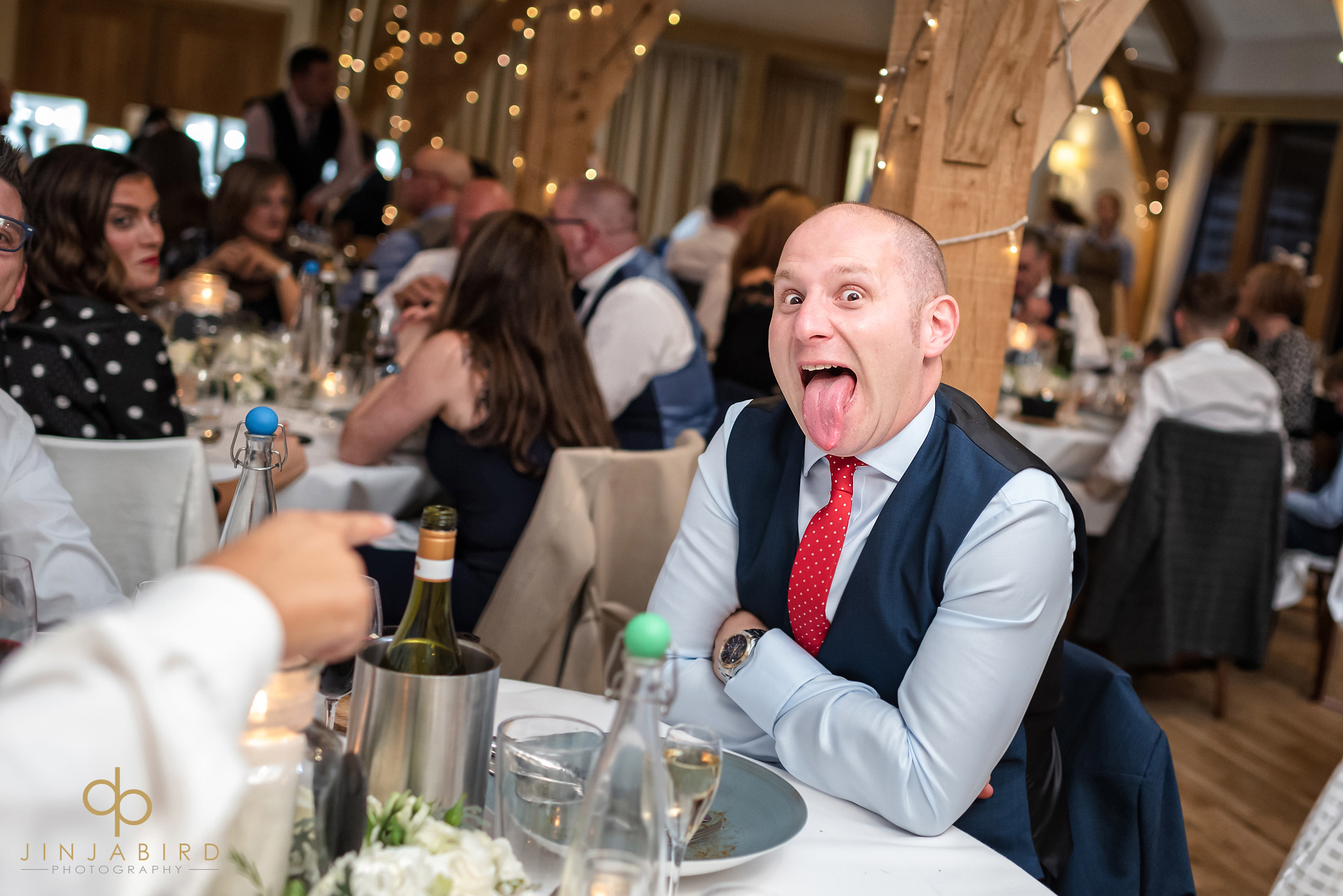 wedding guest with tongue out