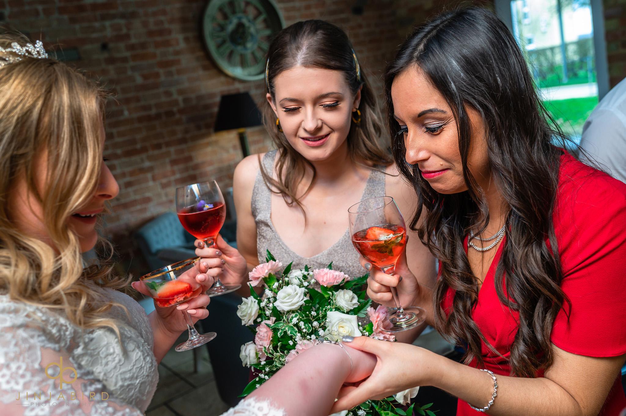 wedding guests looking at brides ring