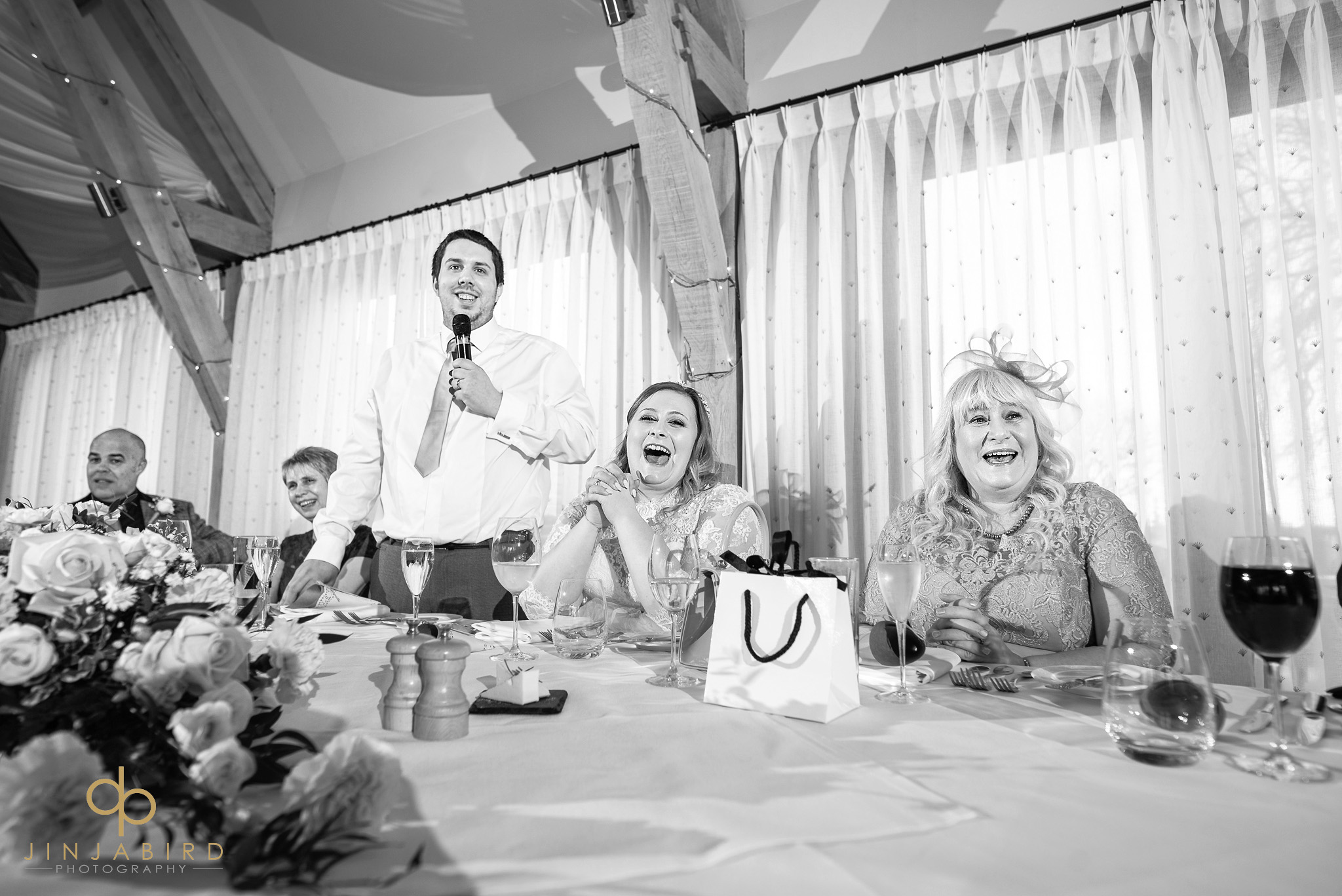 top table laughing at wedding speech