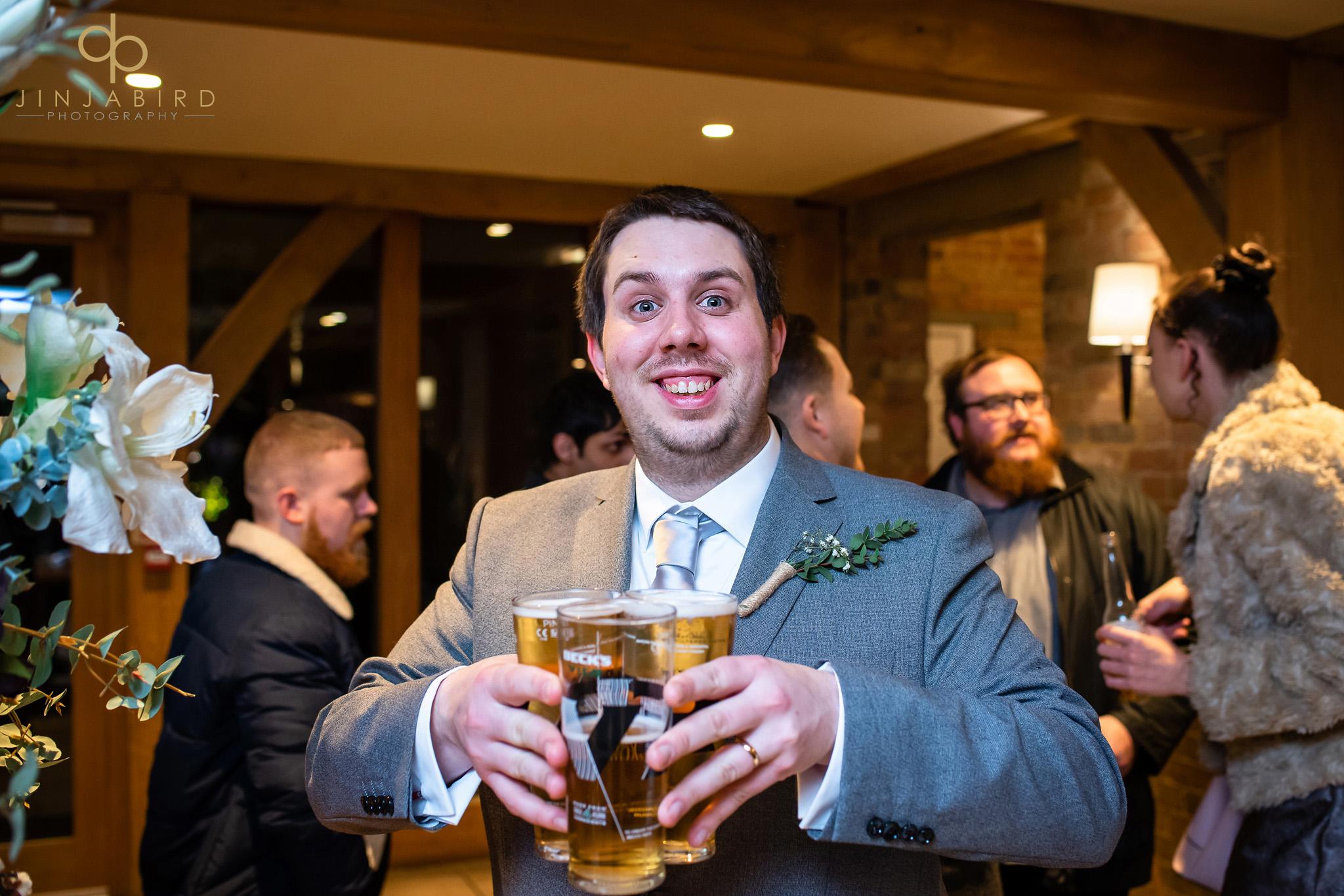 groom holding bear