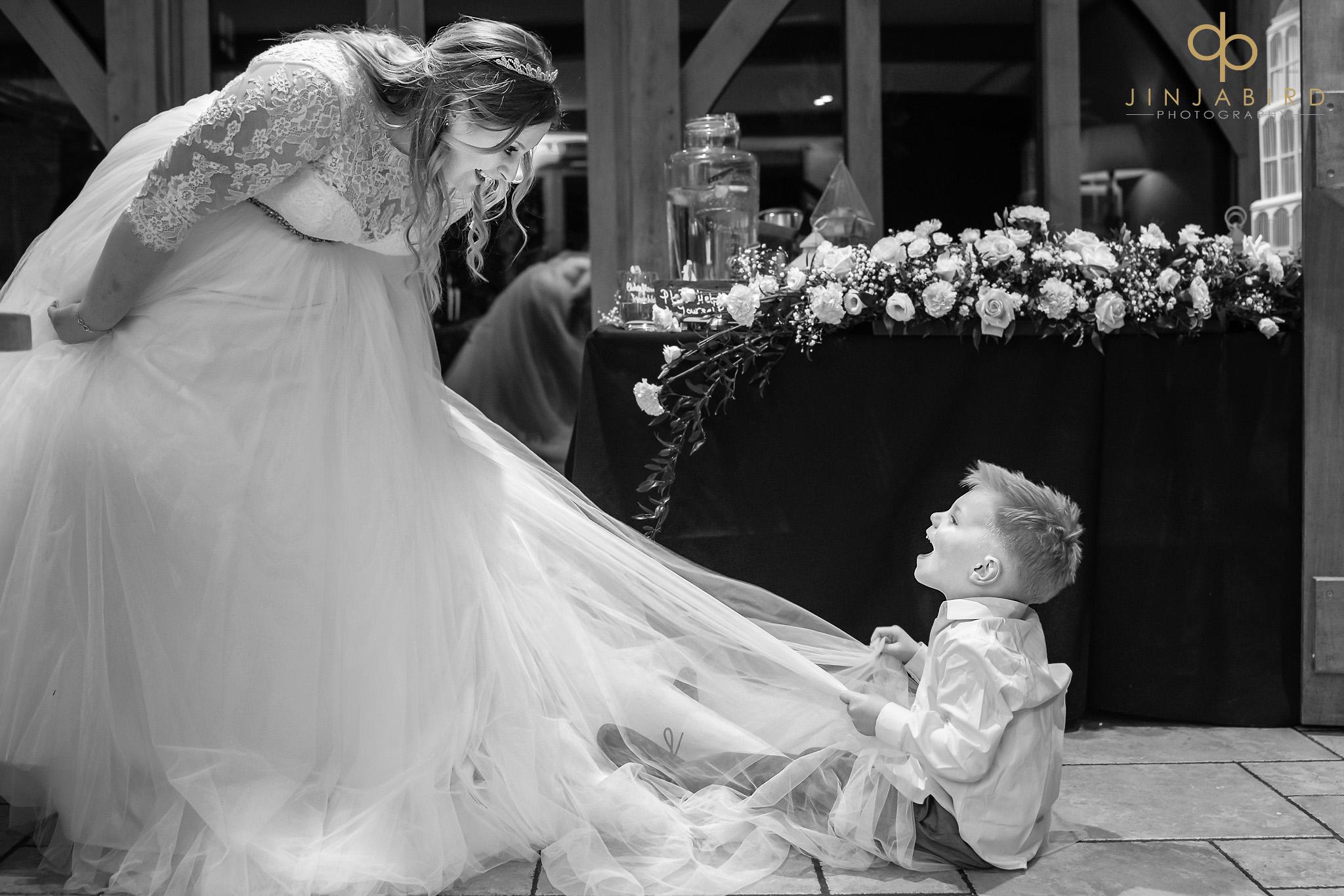 small boy on brides dress