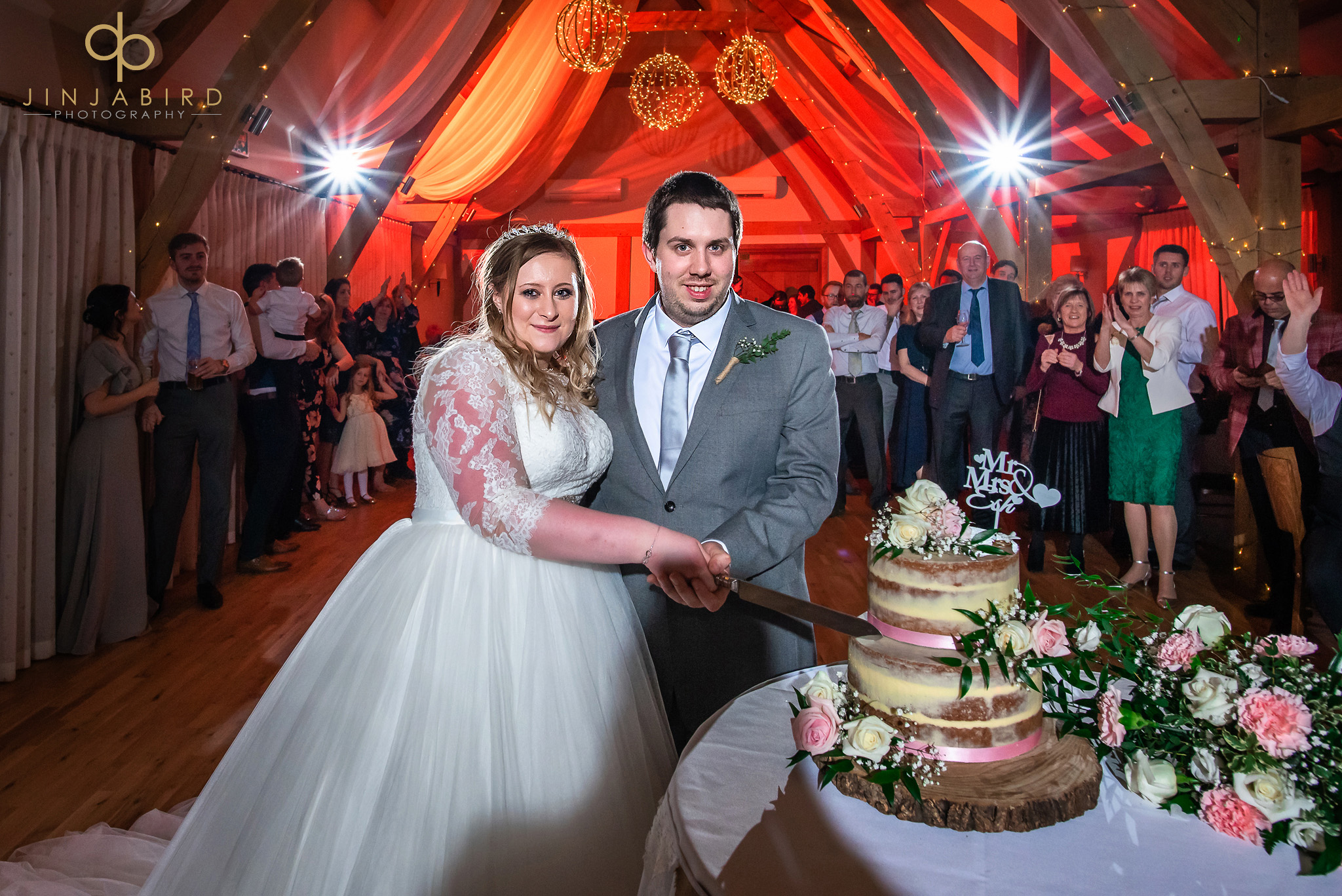 bride with groom cutting cake