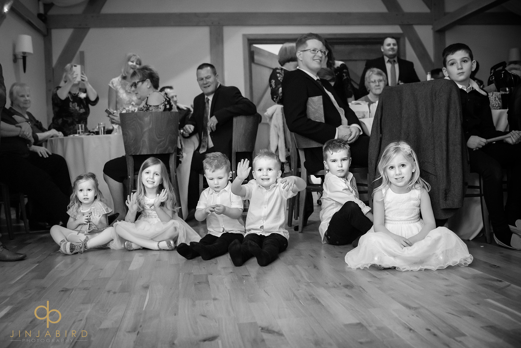 young children watching first dance at wedding