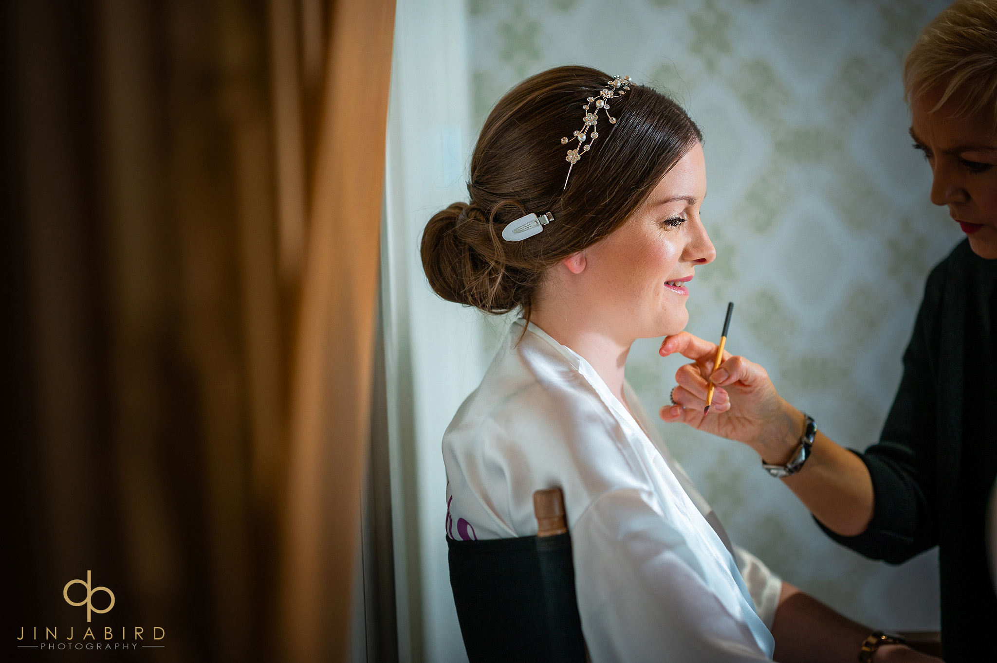 bride having makeup applied bassmead manor