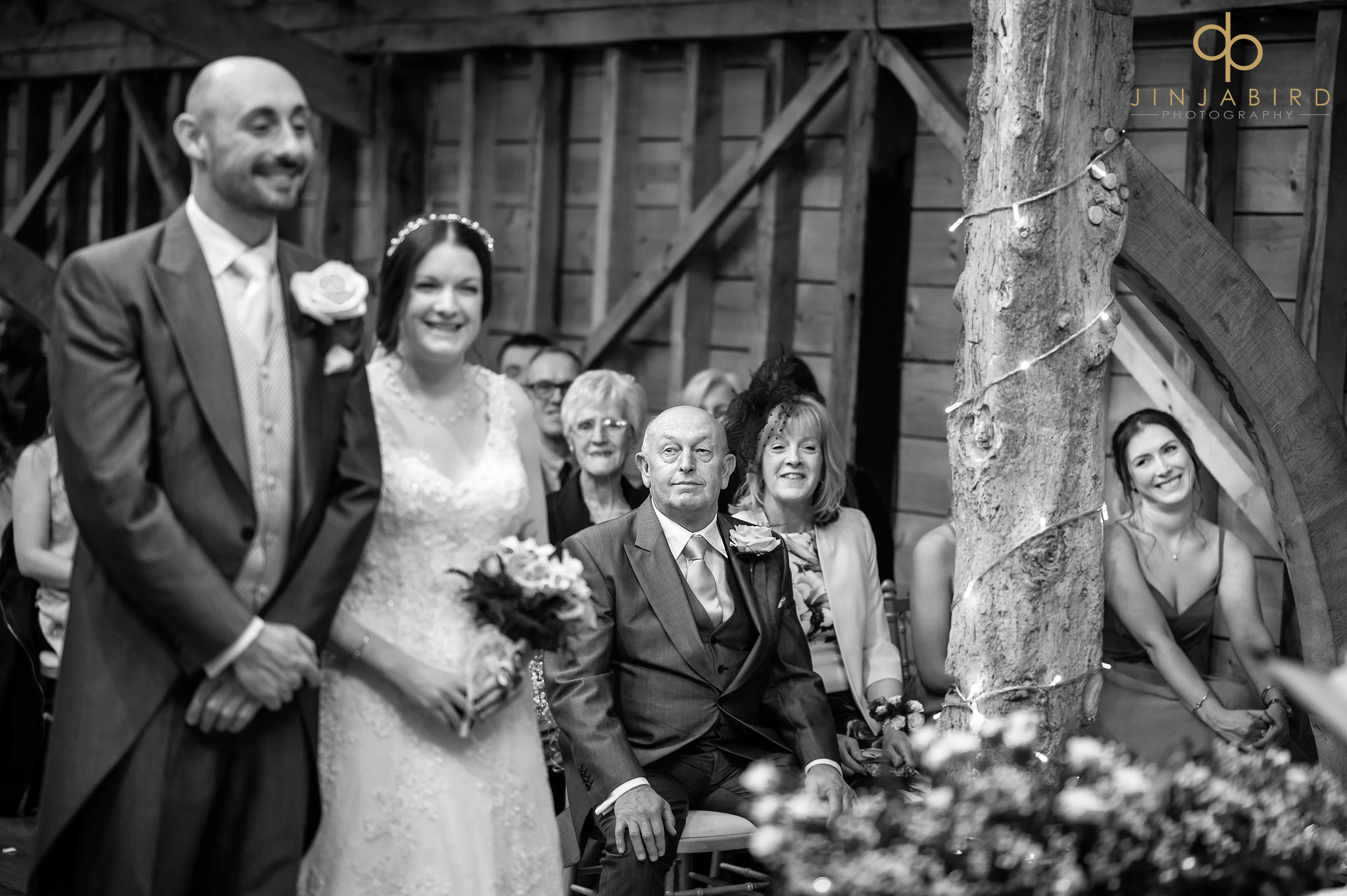 bride and groom in rickety barn bassmead manor