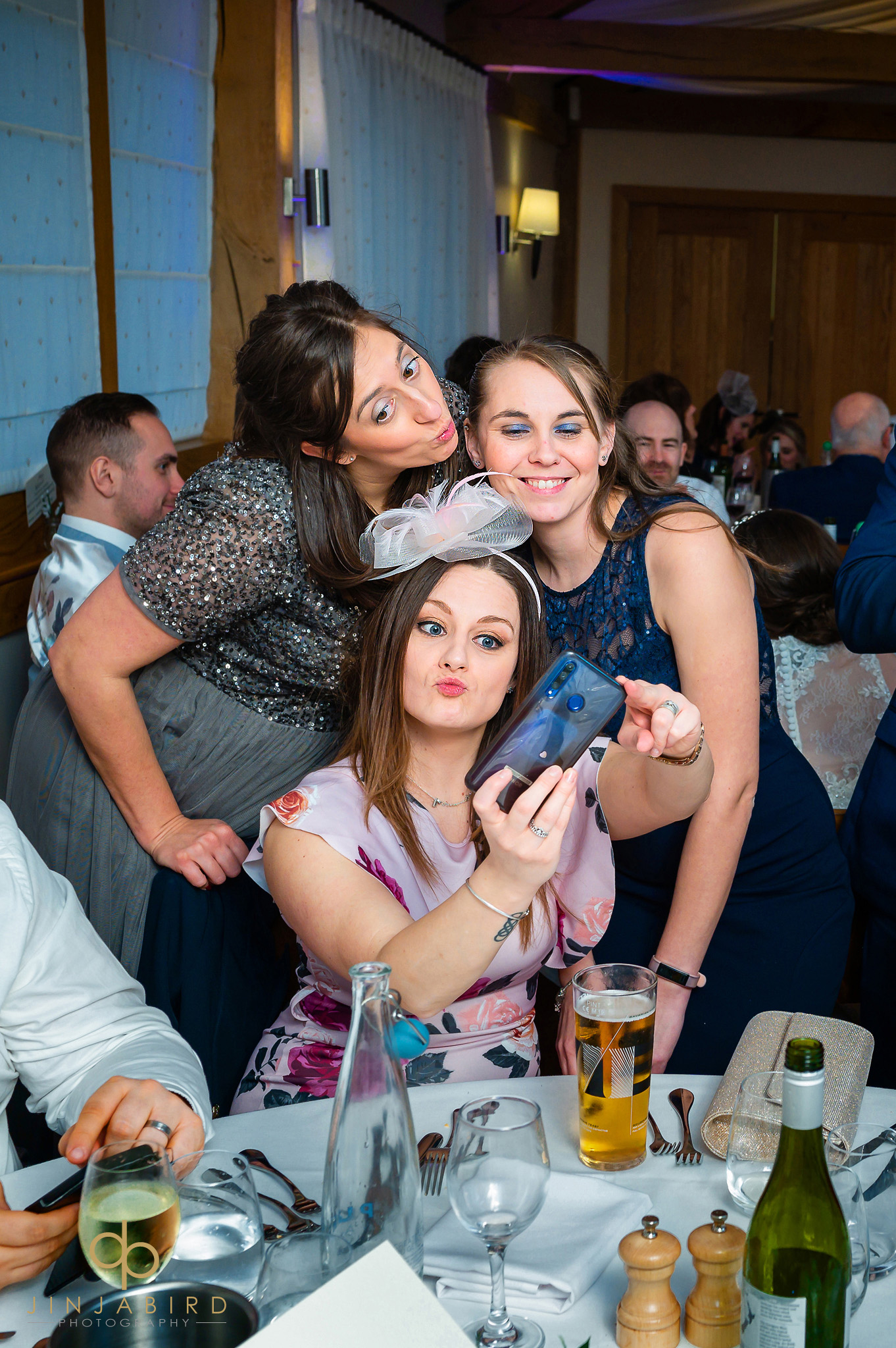 guests taking selfie at wedding