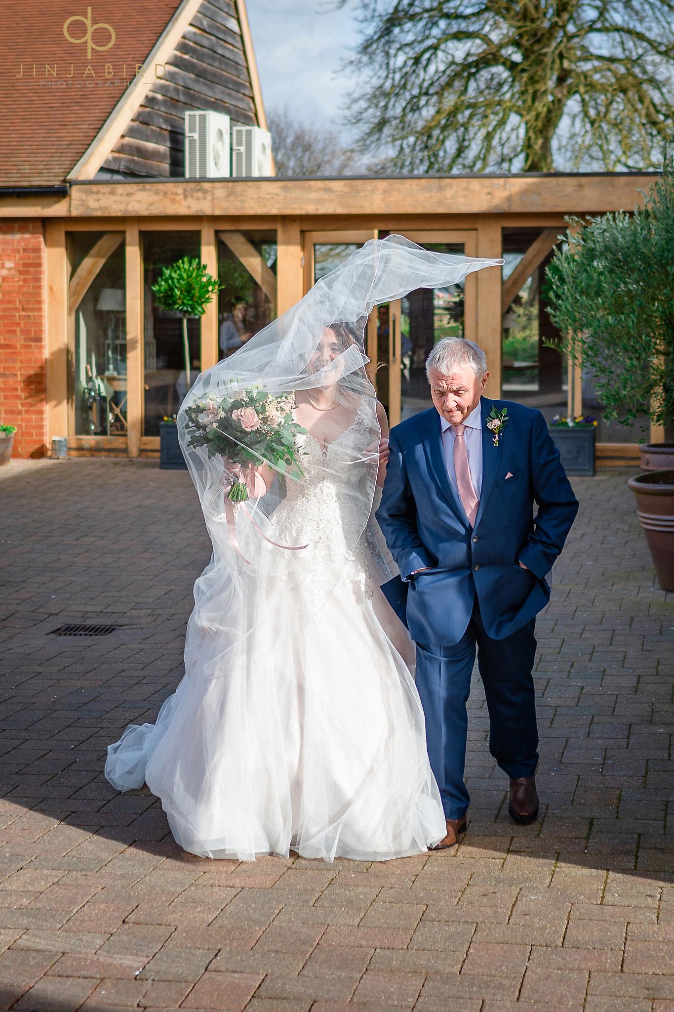 brides veil blowing in wind bassmead manor