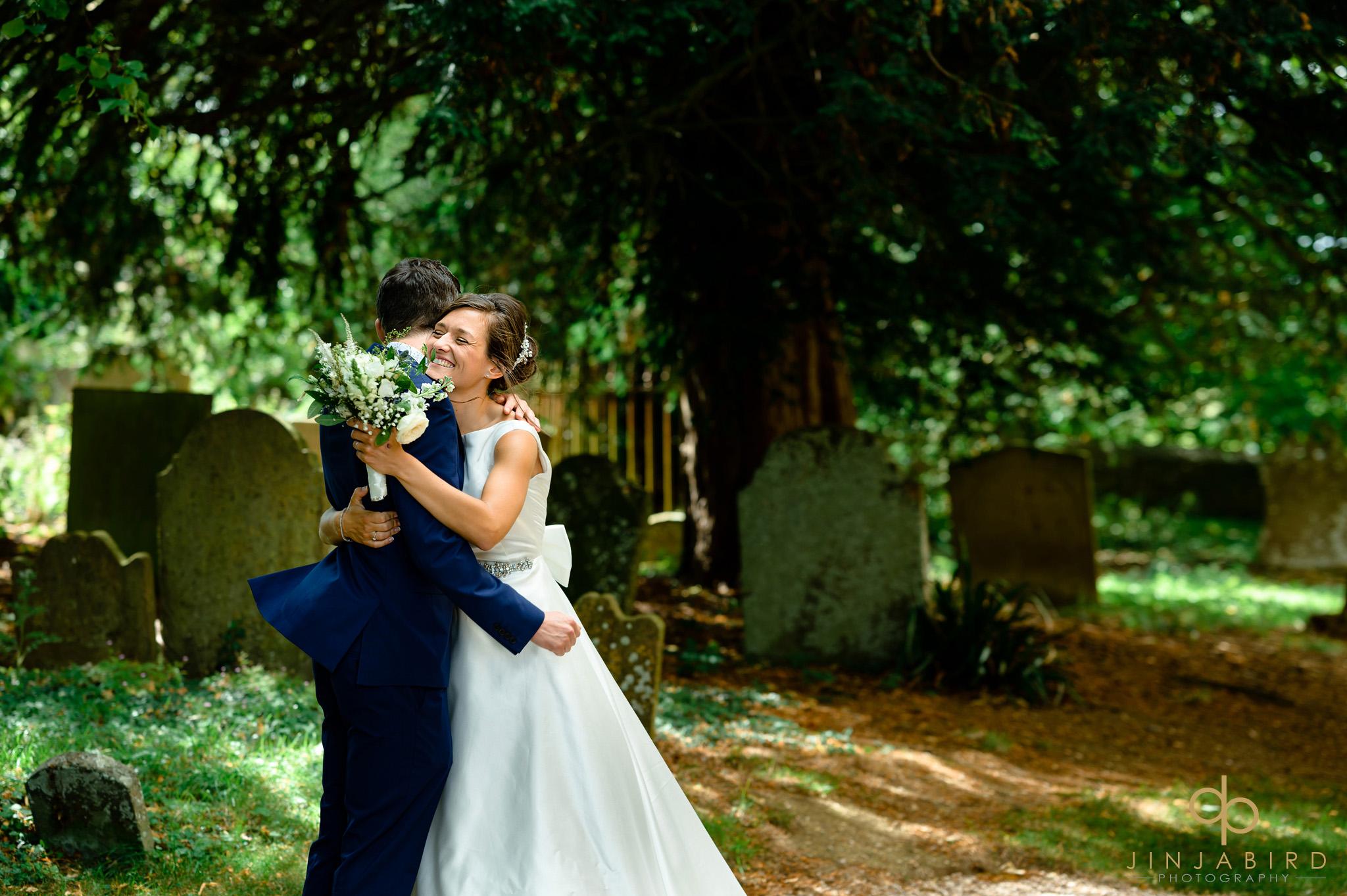 bride hugging groom