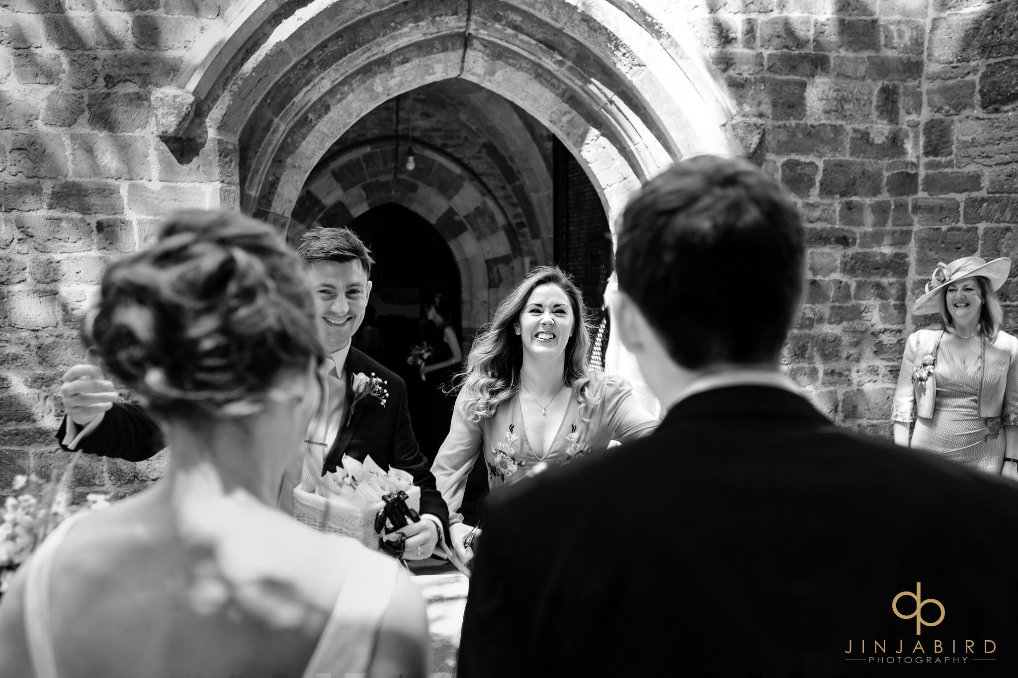 wedding guests greet bride and groom