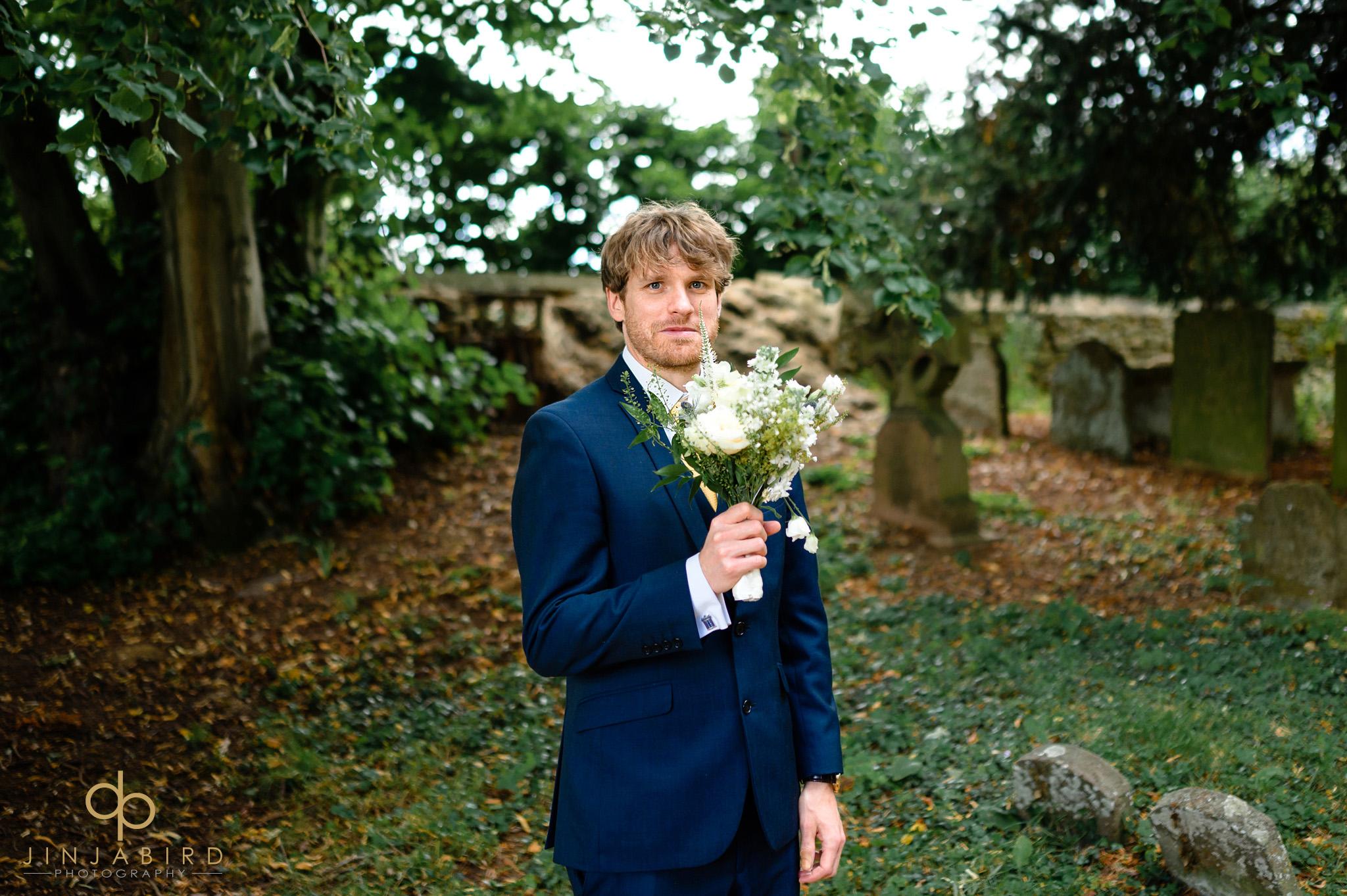best man holding bouquet