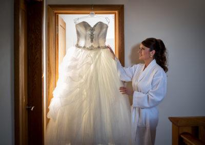 bride-admiring-dress