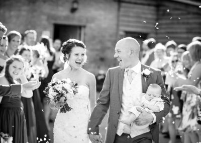 bride-with-groom-holding-baby